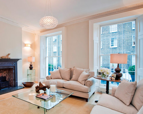 Inspiration For A Transitional Formal Medium Tone Wood Floor Living Room Remodel In London With Beige
