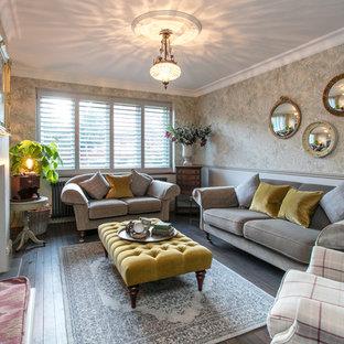 サリーの中サイズのヴィクトリアン調のおしゃれな独立型リビング (フォーマル、グレーの壁、濃色無垢フローリング、薪ストーブ、漆喰の暖炉まわり、テレビなし、茶色い床) の写真