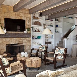 Mid-sized coastal formal and open concept limestone floor and beige floor living room photo in Orange County with white walls, a standard fireplace, a stone fireplace and a wall-mounted tv