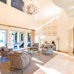 タンパの地中海スタイルのおしゃれなLDK (フォーマル、白い壁、大理石の床、テレビなし、白い床) の写真