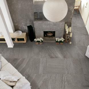 デンバーの中サイズのトランジショナルスタイルのおしゃれなリビング (白い壁、磁器タイルの床、標準型暖炉、コンクリートの暖炉まわり) の写真