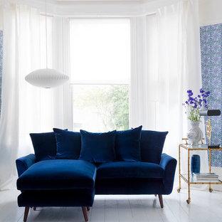 Foto di un piccolo soggiorno minimal con pareti blu