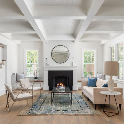 Large transitional open concept and formal light wood floor living room photo in Charlotte with white walls, a standard fireplace and no tv