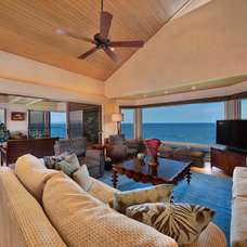 Tropical Living Room by Architectural Design & Construction