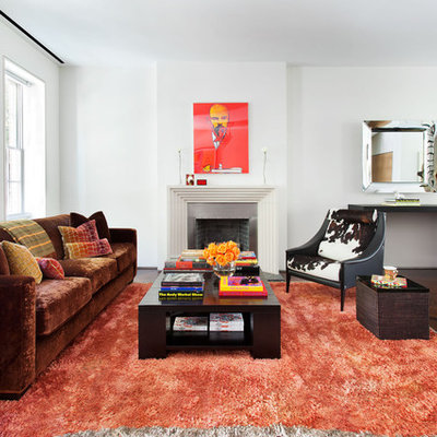 Living room - contemporary enclosed dark wood floor living room idea in New York with white walls, a standard fireplace and no tv