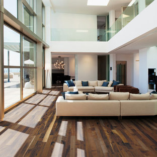 Example of a large trendy formal and open concept dark wood floor and brown floor living room design in Montreal with white walls, no fireplace and no tv