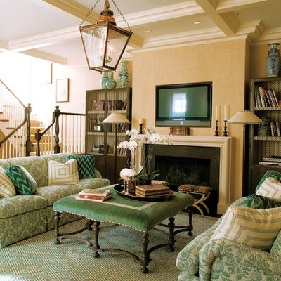 Living room - traditional living room idea in Chicago with a standard fireplace and a wall-mounted tv