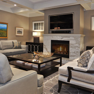 Transitional medium tone wood floor living room photo in Calgary with a stone fireplace, brown walls, a standard fireplace and a wall-mounted tv