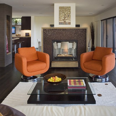 Example of a trendy brown floor living room design in San Francisco with a tile fireplace