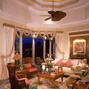 Huge island style living room photo in Miami with beige walls
