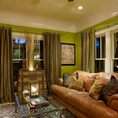 Example of an eclectic enclosed living room design in Phoenix with green walls