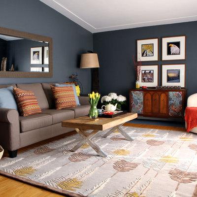 Mid-sized trendy medium tone wood floor living room photo in Toronto with blue walls