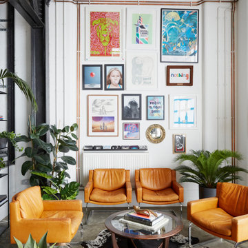 LIVING ROOM | Concrete Flooring, Vintage Armchairs & Gallery Wall