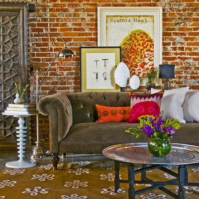 Living room - eclectic living room idea in Kansas City with red walls