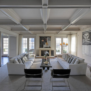 Huge trendy living room photo in New York with white walls