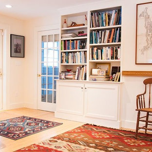Example of a mid-sized classic open concept light wood floor and beige floor living room library design in Boston with beige walls, no fireplace and no tv
