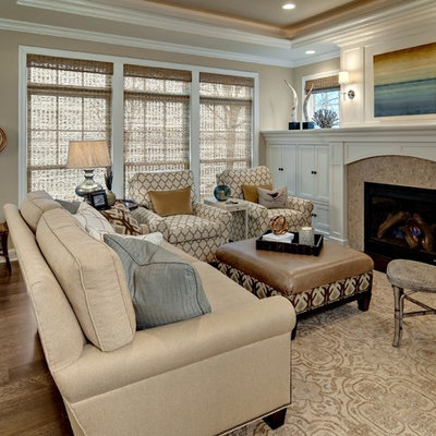 Example of a mid-sized classic formal and enclosed dark wood floor living room design in Minneapolis with beige walls, a standard fireplace, no tv and a wood fireplace surround