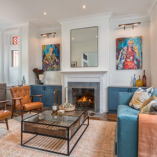 Example of an eclectic formal dark wood floor living room design in DC Metro with white walls, a standard fireplace and no tv