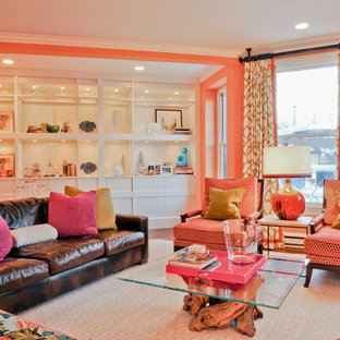 Design ideas for an eclectic living room in Boston with orange walls.