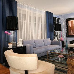 Living room - eclectic medium tone wood floor living room idea in Charleston with blue walls