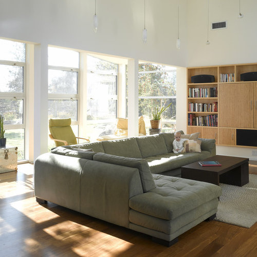 Inspiration for a contemporary open concept living room library remodel in San Francisco with a concealed : roche bobois sectional sofa - Sectionals, Sofas & Couches