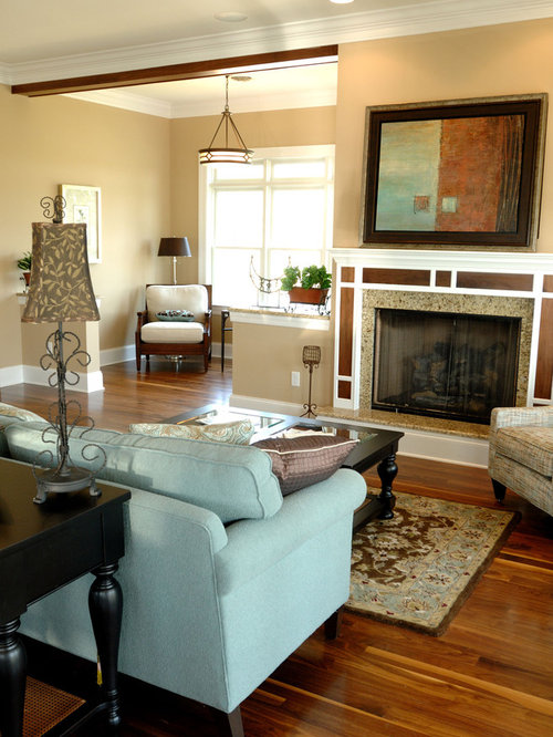 Example of a classic living room design in Other with beige walls and a  standard fireplace