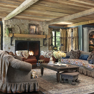 Mid-sized elegant formal and open concept dark wood floor and brown floor living room photo in St Louis with blue walls, a stone fireplace, a standard fireplace and no tv