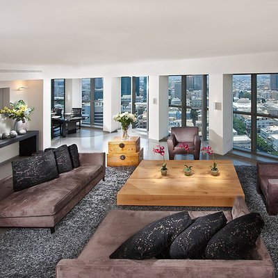 Example of a huge trendy living room design in Other with white walls
