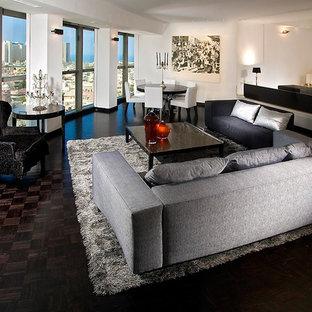 Idee per un ampio soggiorno design con pareti bianche e nessuna TV