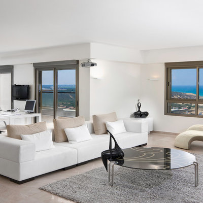 Inspiration for a contemporary open concept beige floor living room remodel in Other with white walls