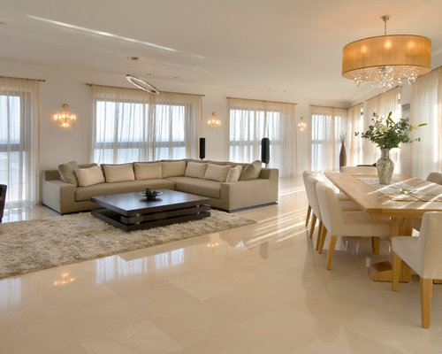 Example Of A Trendy Open Concept Beige Floor Living Room Design In Other