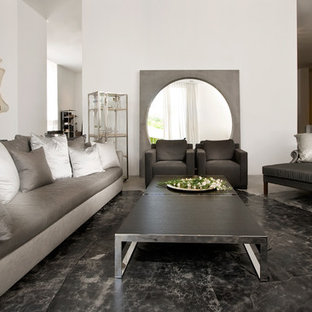 Example of a minimalist black floor living room design in Other with white walls