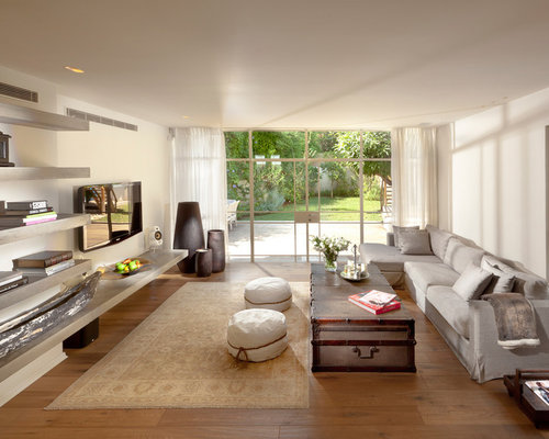 Example Of A Trendy Living Room Design In Other With White Walls And Wall