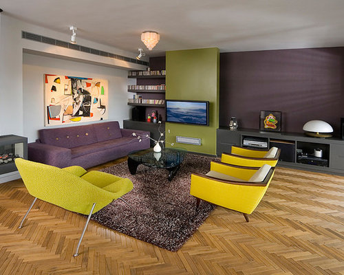 1950s medium tone wood floor living room idea in Other with purple walls  and a hanging