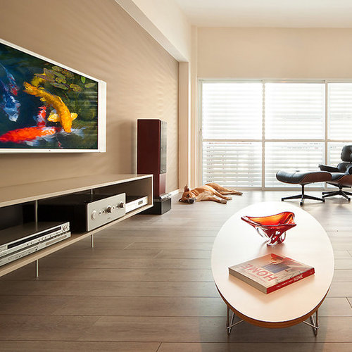 Wonderful Example Of A Minimalist Living Room Design In Other With A Wall Mounted Tv