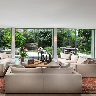 Inspiration for a huge contemporary living room remodel in Other with white walls