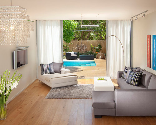 Mid Sized Contemporary Living Room Idea In Other With A Wall Mounted Tv