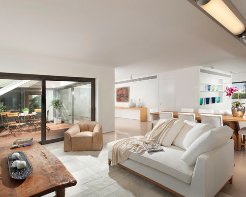 Inspiration For A Contemporary Open Concept Living Room Remodel In Other  With White Walls