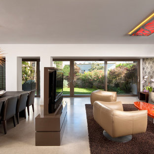 This is an example of a contemporary open plan living room in Other with a wall mounted tv.