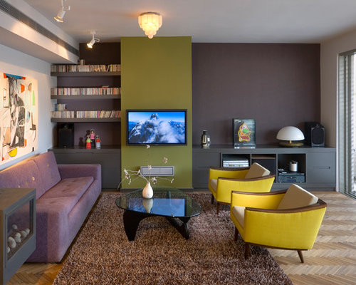 Example Of A Trendy Living Room Design In Other With Gray Walls And A Wall