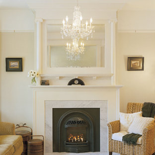 Inspiration for a traditional living room in Portland with beige walls and a standard fireplace.