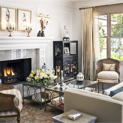 Mid-sized elegant formal and enclosed dark wood floor and brown floor living room photo in Los Angeles with gray walls, a standard fireplace and no tv