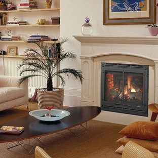 Inspiration for a mid-sized beach style enclosed carpeted living room remodel in New York with beige walls, a standard fireplace and a plaster fireplace