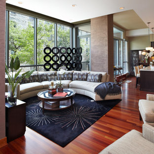 This is an example of a contemporary open concept living room in Minneapolis with no tv and red floor.