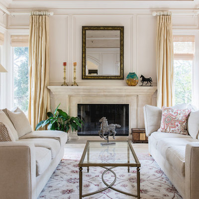 Living room - large traditional formal and enclosed living room idea in San Francisco with beige walls, a standard fireplace, a stone fireplace and no tv