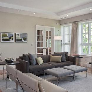 Trendy medium tone wood floor living room photo in Boston with gray walls