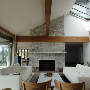 Inspiration for an eclectic living room remodel in Vancouver with white walls, a standard fireplace and a stone fireplace
