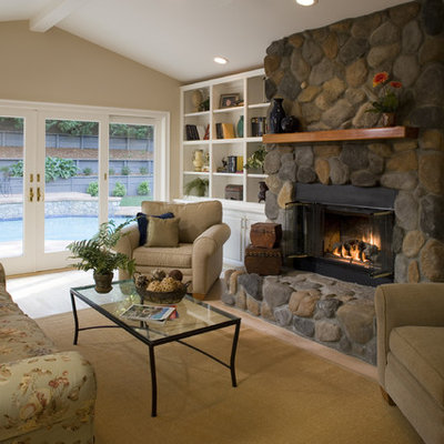 Living room - traditional living room idea in San Francisco with a standard fireplace and a stone fireplace