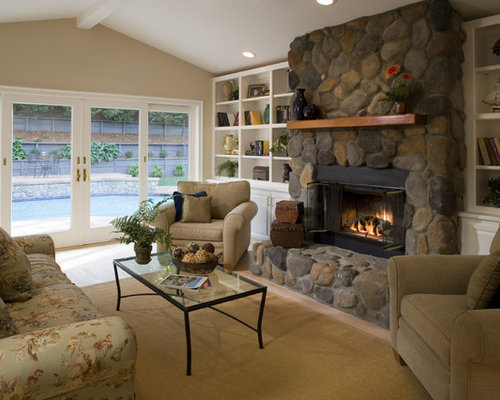 Traditional living room idea in San Francisco with a standard fireplace and  a stone fireplace
