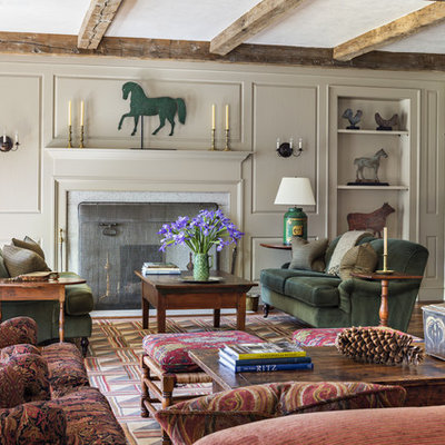 Living room - huge country medium tone wood floor living room idea in New York with multicolored walls, a standard fireplace, a stone fireplace and a concealed tv